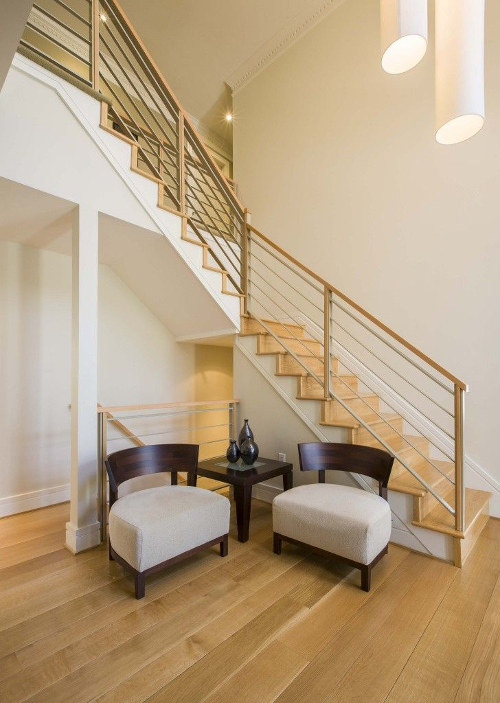 homestratosphere.com   View of staircase from main level, replete with light natural wood ...