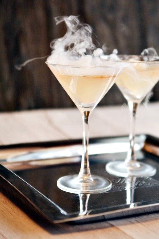 Smokin' martinis  made with 3 ounces Pisco Brandy  1 ounce fresh lime juice  1 ounce fresh lemon juice  1½ tablespoons granulated sugar  Crushed ice  Dash of Angostoria bitters  Dry ice (optional) (see note)