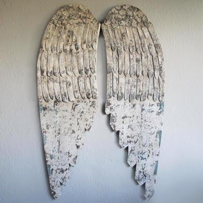Huge, wooden wings on the wall.  Swoon!