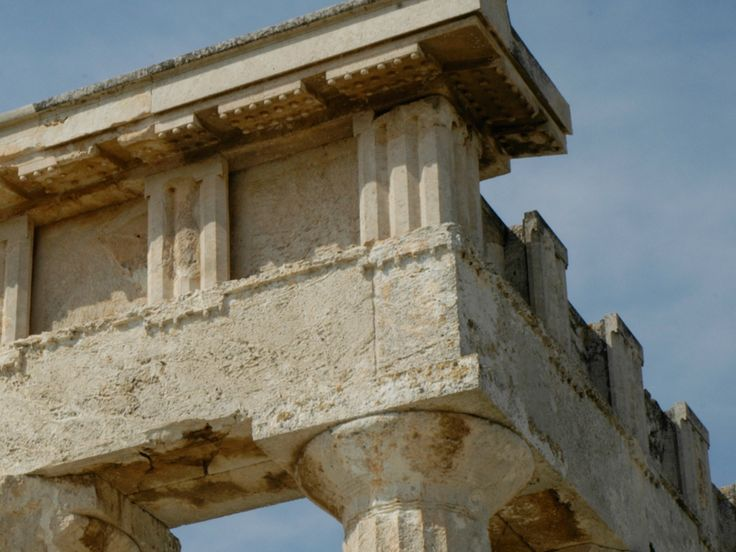 Doric frieze and horizontal geisa of the Temple of Aphaia II showing slotted…
