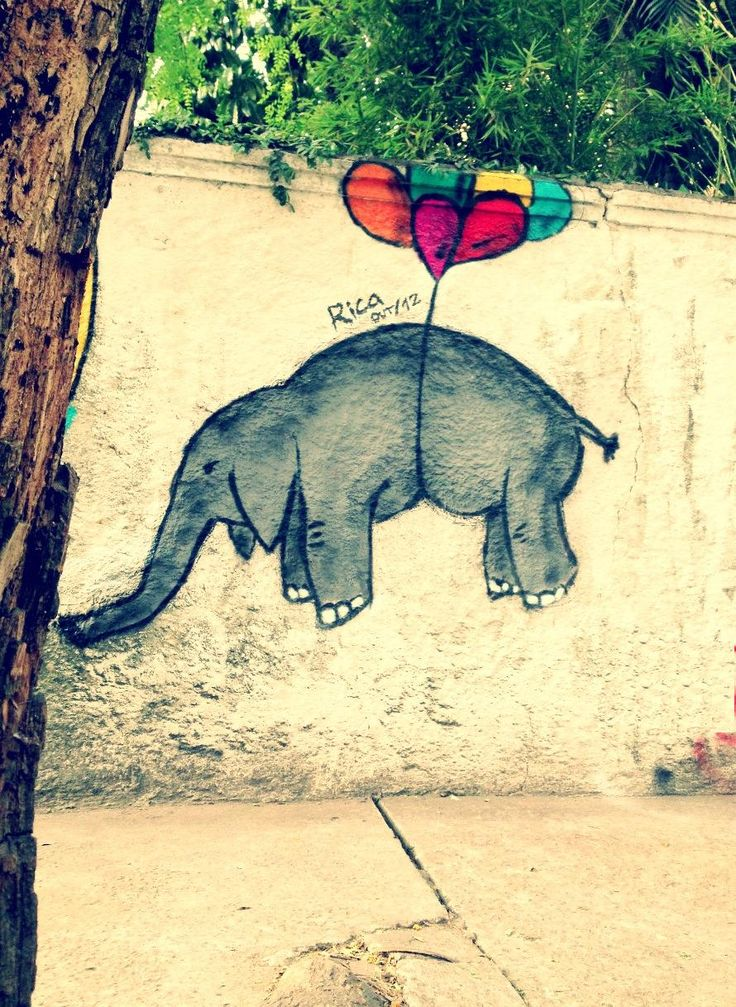 Street Art by Rica in São Paulo, Brazil  I so believe this elephant is being lifted by the balloons.  Kudos to Rica in Sao Paulo.   #modifying_social_behavior