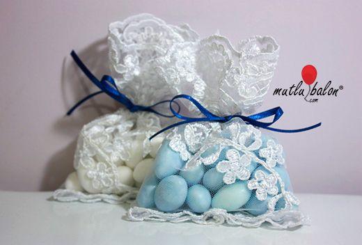 Renkli badem şekeri veya draje çikolatalardan oluşan tüllü nikah ve bebek şekeri modeli. Dilediğiniz renk süsleme ve aksesuar ile hazırlanabilmektedir.