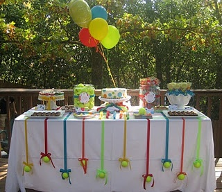 A treat table for a doggie paw-ty. Note on the dangling tennis balls