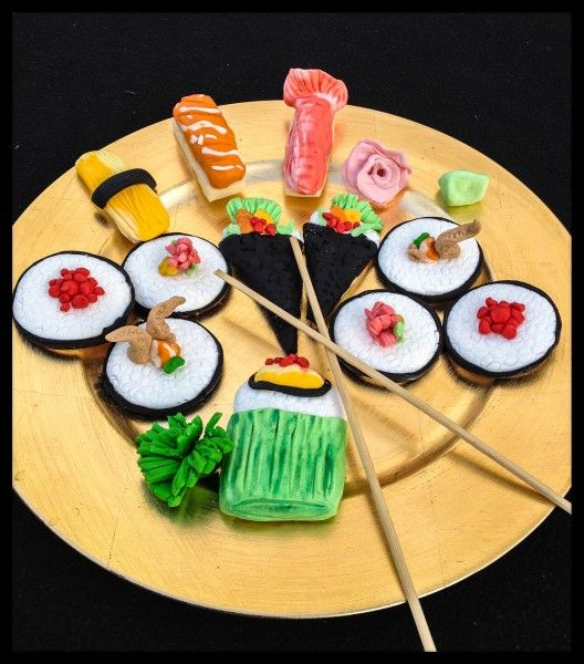 Sushi cookies decorated with roll-able sugar paste frosting made from any ordinary buttercream.