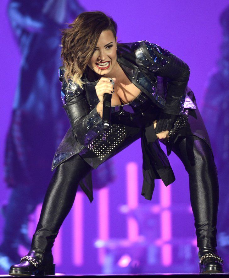 Pin for Later: Can't-Miss Celebrity Pics!  Demi Lovato got lost in the music at her concert in Denver on Thursday.