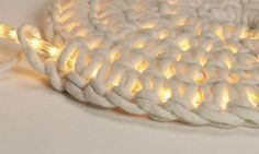 Crochet around rope light to make an outdoor floor mat. this is one of the coolest things I've ever seen..