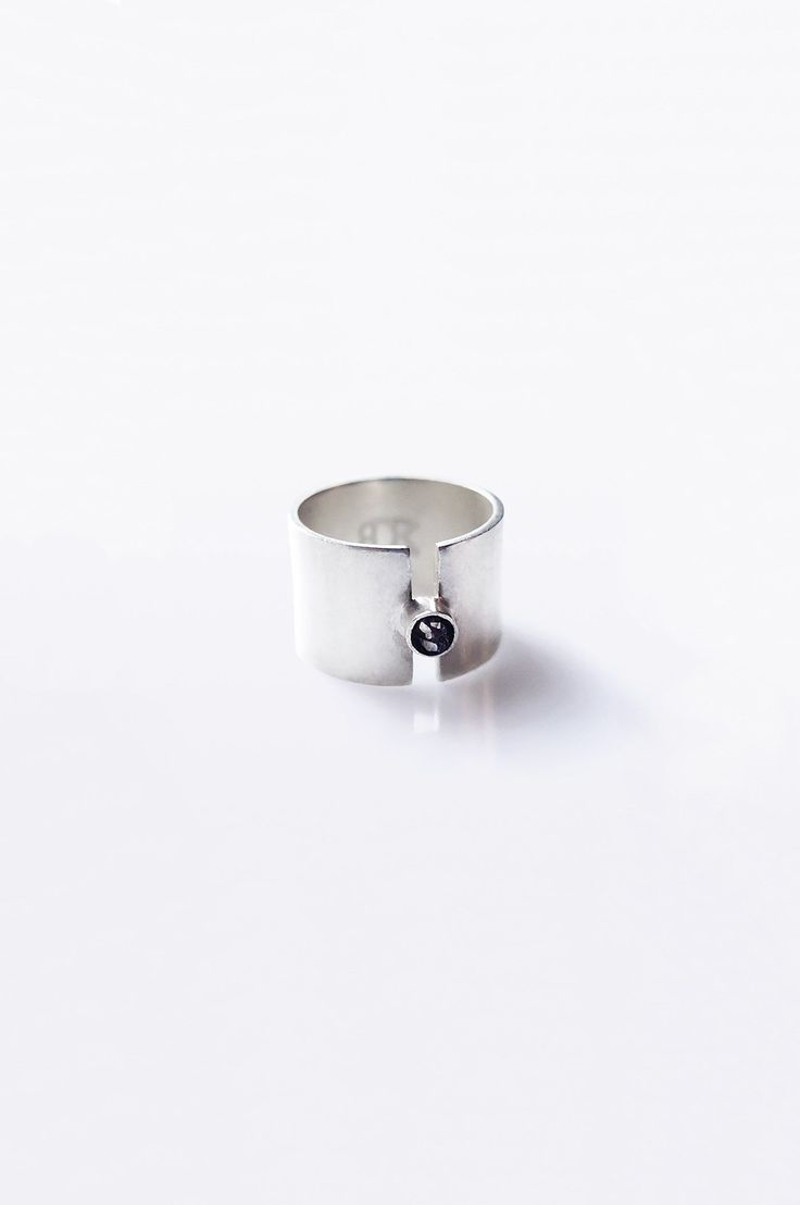 Diamond Band Ring by Swedish brand Baumgarten Di Marco is a handcrafted raw diamond band ring in ste...