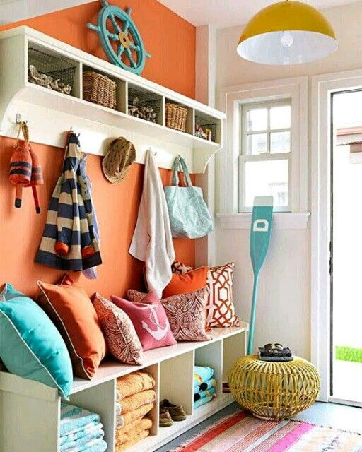 Great Mud Room. Love the orange, and this is exactly like our mud room! Trev will just have to get used to this orange haha