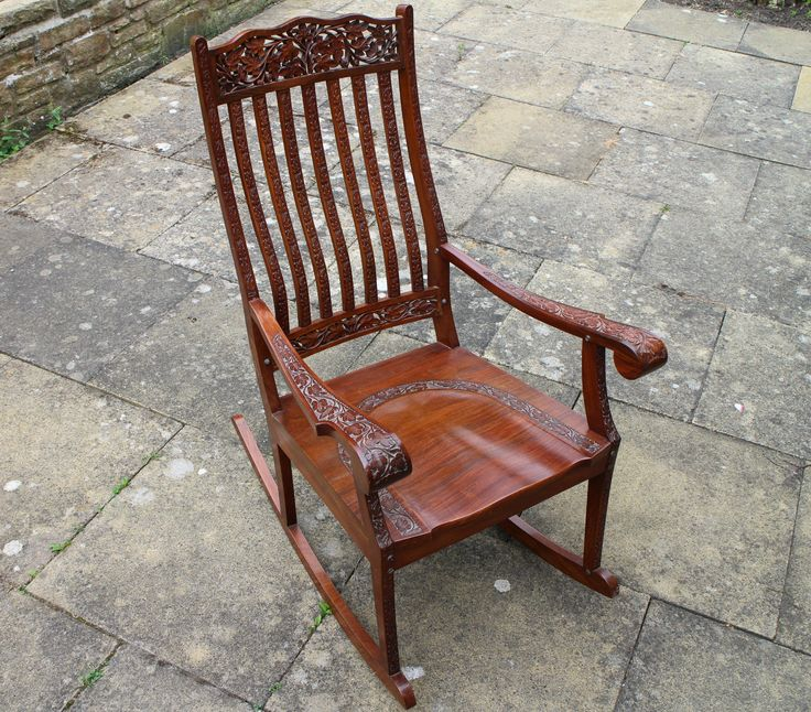 Sold! Lovely large solid wooden rocking chair with ornate carvings. Size is 42 inches in height x 24 inches wide and 21 inches deep. Generous seat.