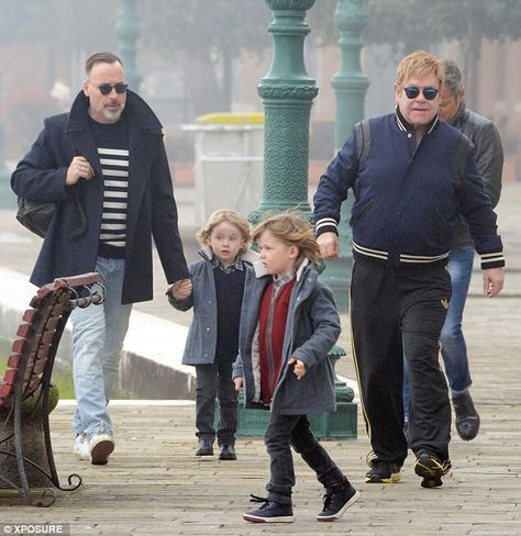 Family time: Sir Elton John and his husband David Furnish enjoy an afternoon stroll in Ven...