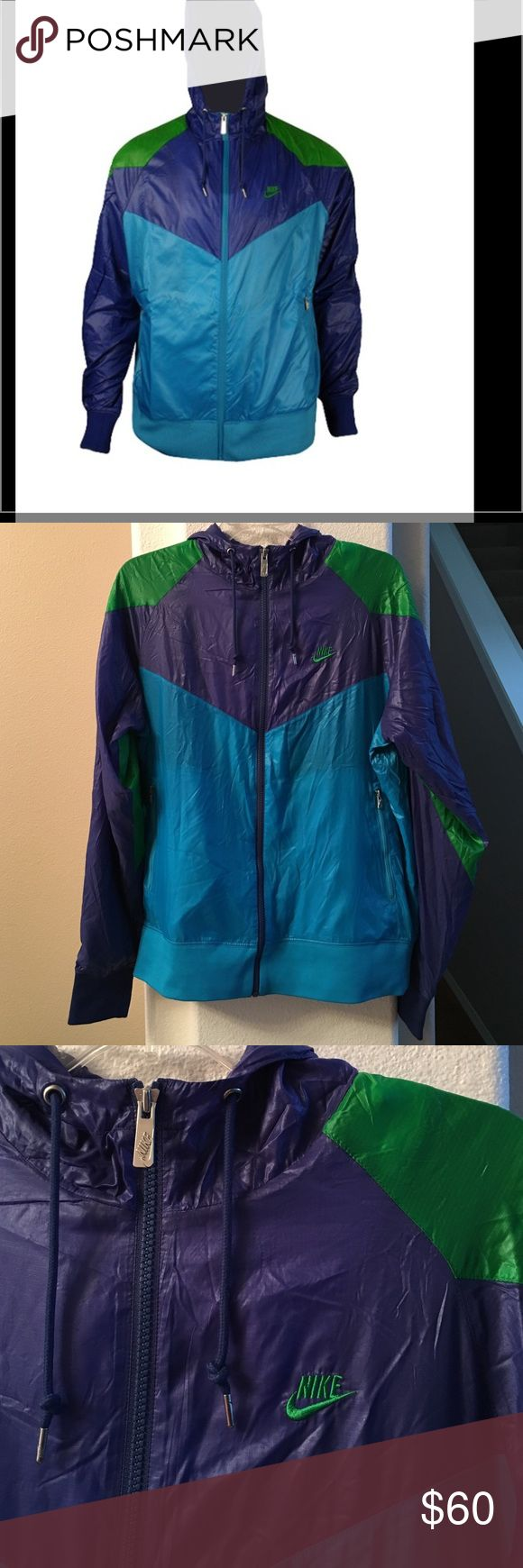 """New Listing! Men's Nike Retro Windrunner Men's Nike retro Windrunner Jacket. Elastic waist and cuffs, two front outer pockets with zippers, hood with drawstring. Complete with vintage old school Nike logo embroidered on chest. Size medium. Excellent used condition! 22"""" across chest and 26.5"""" long. Nike Jackets & Coats Windbreakers"""