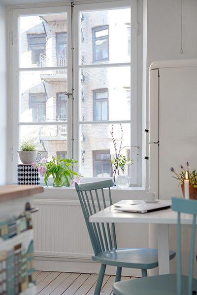 a white and aqua kitchen