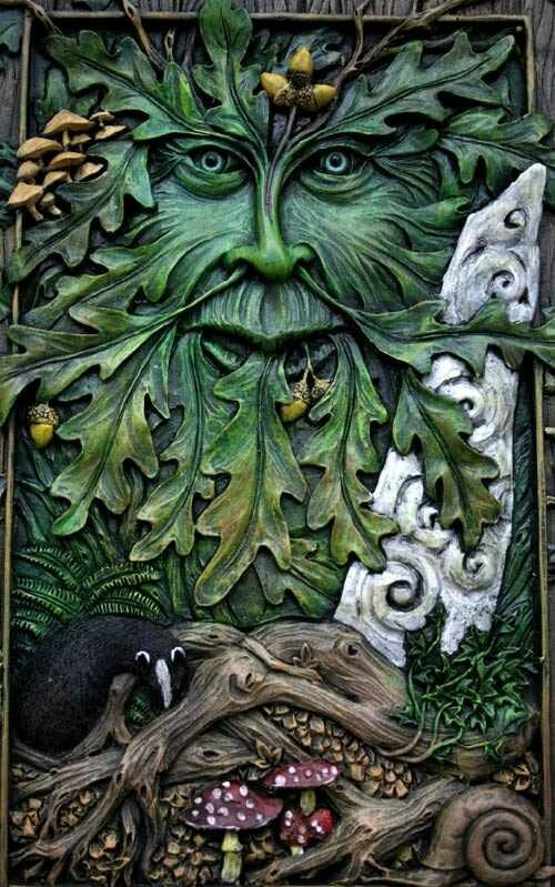 """Magick Greenman with Acorns, mushrooms, a Celtic stone, a crow and a Amanita muscaria mushroom (said to give the ingredient for """"flying balm"""")."""