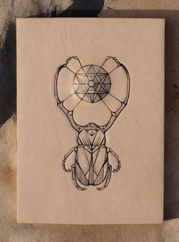 """Geometric bug mandala"". Entomology series. Punctured Artefact. Tattooed leather, edition of 16."