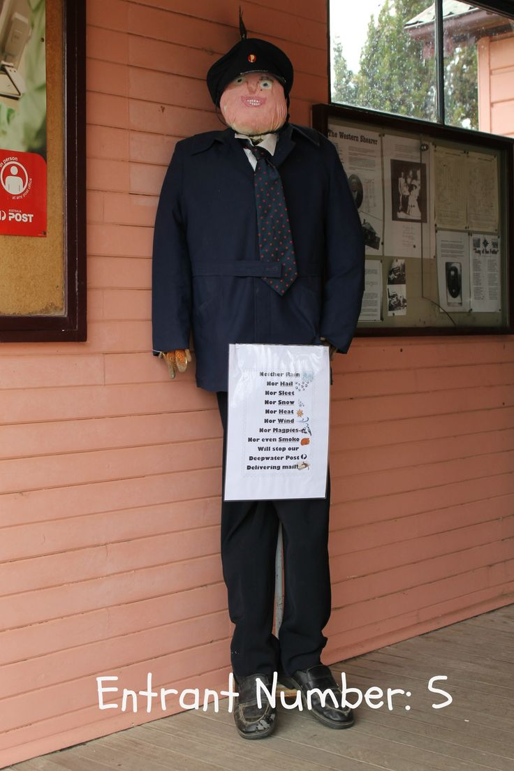 Neither Rain,  Nor Hail, Nor Sleet, Nor Snow,  Nor Heat,  Nor Wind,  Nor Magpies,  Nor even Smoko,  Will stop our Deepwater Post from delivering mail! Postman Russ harassed by a magpie!!! at the 2012 Deepwater Scarecrow & Wool Festival NSW. https://www.facebook.com/LMPixCapturedMemoriesByLou