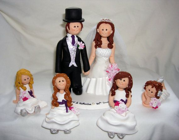 Bride and groom with kids wedding cake topper by ALittleRelic