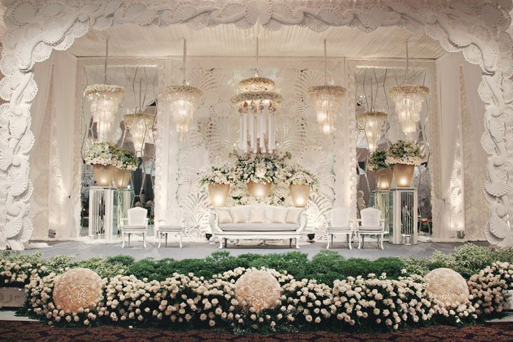 "Amazing floral arrangements! Photo by Axioo. Flowers and decor by Nefi Decor. Luxe ""Sea Shells & Pearls"" Wedding: Jerry and Selina #jakarta #jakartawedding"