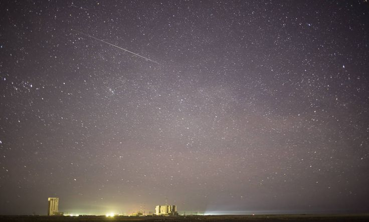In this one minute exposure, a meteor streaks across the sky as the Soyuz TMA-19M spacecraft is rolled out by train to the launch pad at the Baikonur Cosmodrome on Sunday, Dec. 13, 2015 in Kazakhstan. Launch of the Soyuz is scheduled for Dec. 15 and will send Expedition 46 Soyuz Commander Yuri Malenchenko of the Russian Federal Space Agency (Roscosmos), Flight Engineer Tim Kopra of NASA, and Flight Engineer Tim Peake of ESA (European Space Agency) to the International Space Station for a…