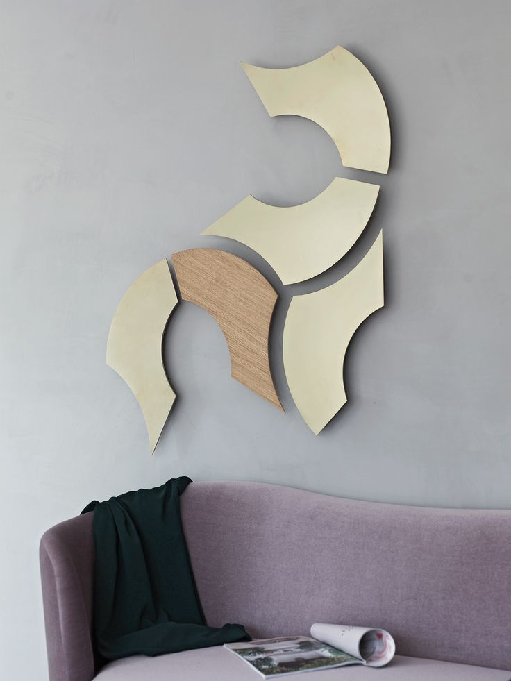 XOX in untreated brushed brass and oak. The regular and inverted versions let you play with the shapes even more.