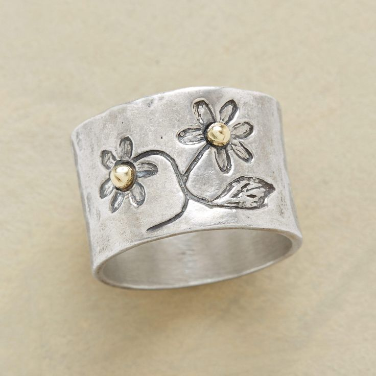 "FRESHLY PICKED RING -- This gold bead flower ring captures two blossoms plucked from the artist's imagination, blooming forever and a day. Hand cast in oxidized sterling silver, dotted with 14kt gold beads. Sundance exclusive. Whole sizes 5 to 9. 1/2""W."