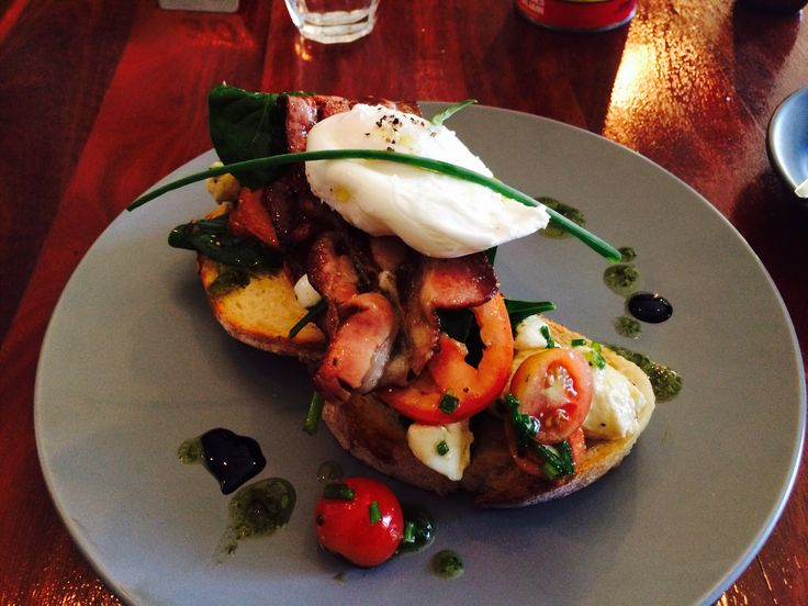 Breakfast bruschetta with goats cheese, Aussie bacon, poached egg with salsa verde and balsamic drizzle.