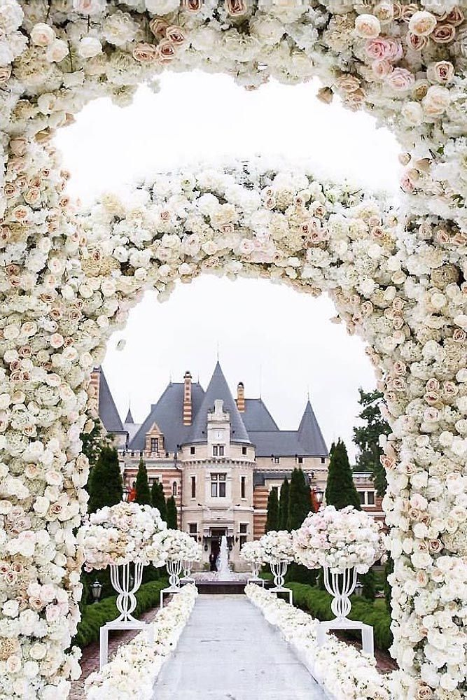 wedding decorations white ideas flower arch and passage on the background of a fairytale castle wedding dream via instagram