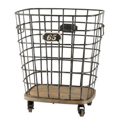Look for quirky storage solutions that combine metal and wood. This industrial style basket on wheels is fab for storing firewood #IWANTTHATSTYLE
