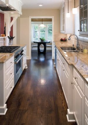 Love the dark wood floors, white cabinets, and light granite counter combination