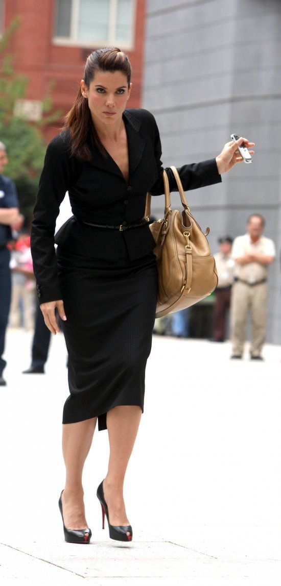 Sandra Bullock: The Proposal.  Perfectly fitted suit, peplum jacket, amazing heels, and do not ignore that handbag!