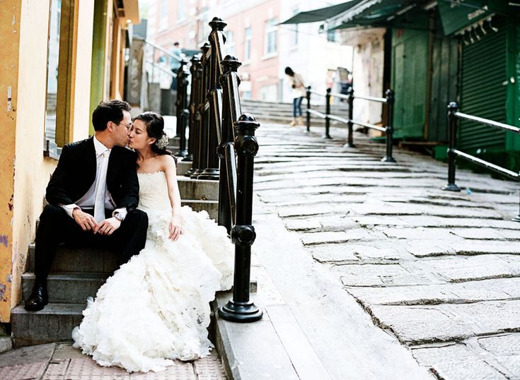 Hong Kong wedding - kiss on a stoop. Click to see and learn more about Hong Kong destination weddings: http://blog.mangomuseevents.com/2012/04/13/destination-wedding-location-series-hong-kong/