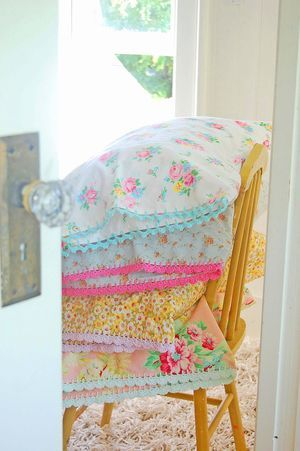 vintage sheets, yellow chair, pretty pillows, glass door knobs