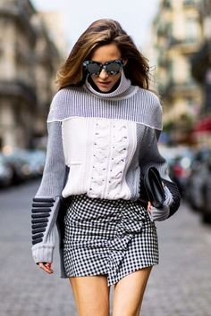 While simple cable knits are fine to pair with jeans for a fall day, there is a selection of chic sweaters that can read luxe with the simple addition of a standout trend piece. Here, five outfit formulas featuring knits from the Rachel Zoe Collection.