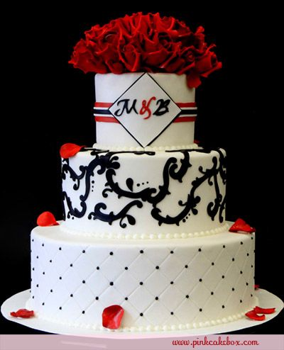 Thinking about this one but not sold. I kinda like square cakes...kinda like this one. http://blog.pinkcakebox.com/red-scrolls-wedding-cake-2010-10-14.htm