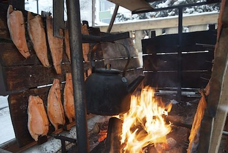Toivolan-vanha-piha-loimulohi-nokipannu. There you can see salmon fried on fire ( delicious ) and coffee pot over fire. You can also buy some and taste it!