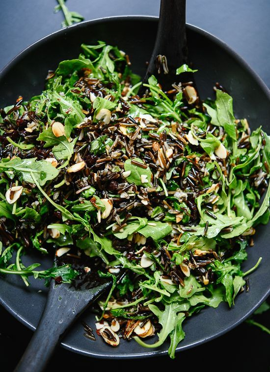 Arugula and wild rice salad recipe with dried cherries, toasted almonds and feta! It's irresistible.
