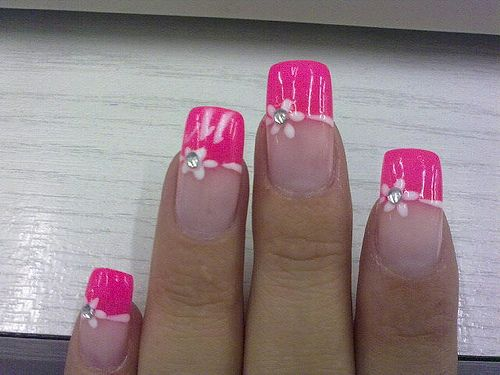 Hot pink french manicure style tips with light pink free hand floral work - free hand nail art