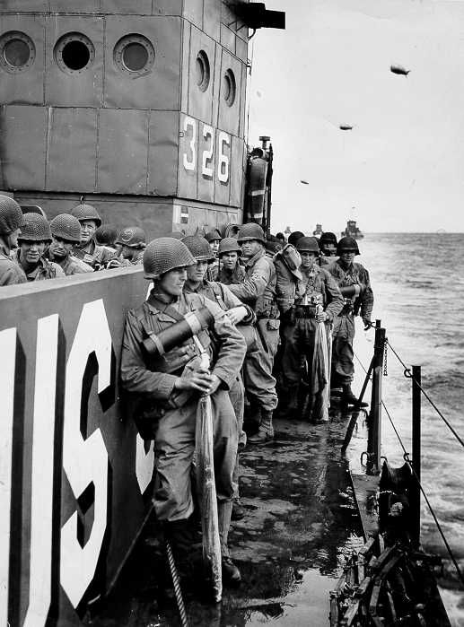 An American ship on the way to land at Normandy, June 6, 1944. U.S. Coast Guard photograph.
