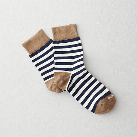 brown with white and blue striped socks <3