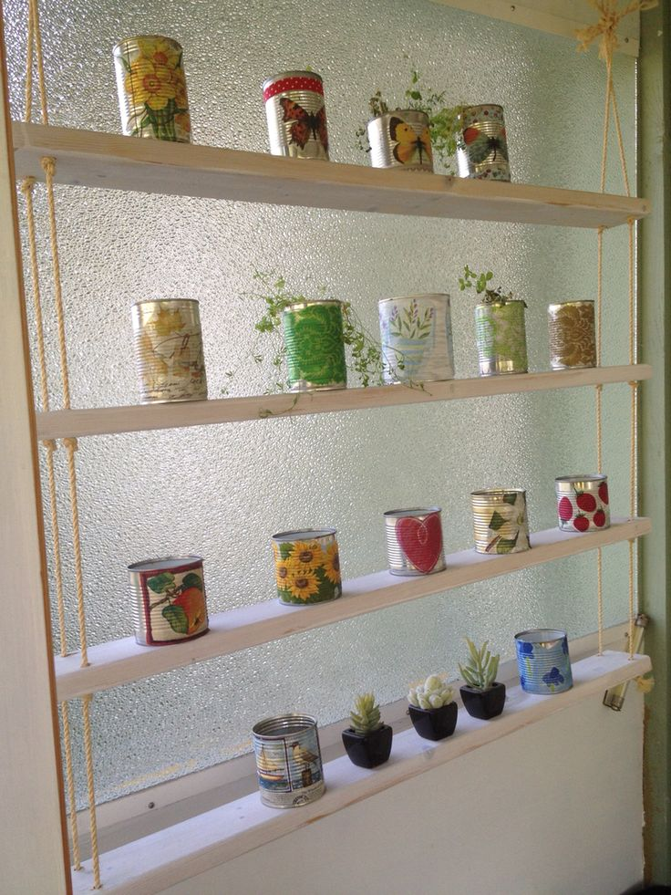 Selfmade shelf for herbs. I also made these small pots for herbs out of tincans using decoupge technique