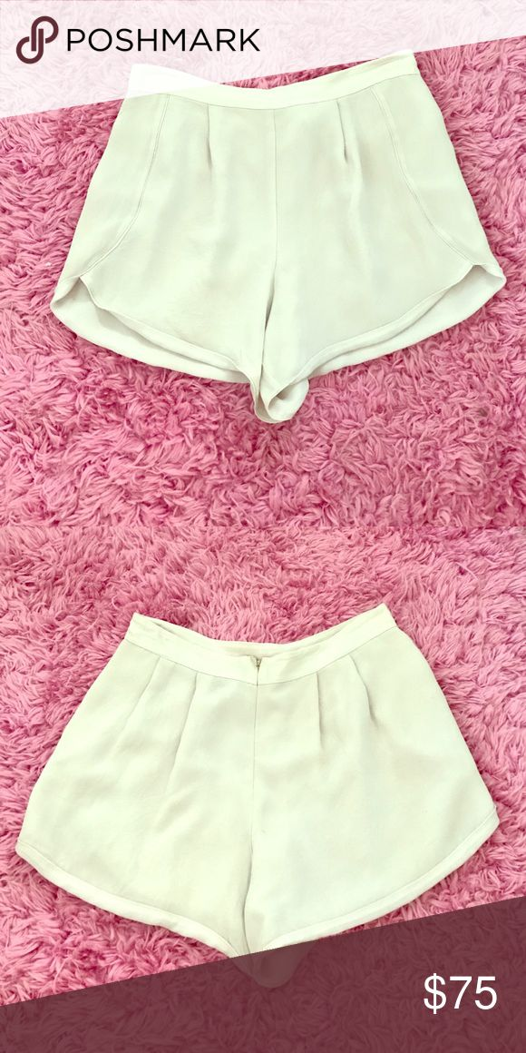 High Waisted Shorts Soft chiffon like material cream colored high waisted shorts. Zip up back enclosure. So cute with a crop top and wedges for the spring/summer! **never been worn** Reiss Shorts