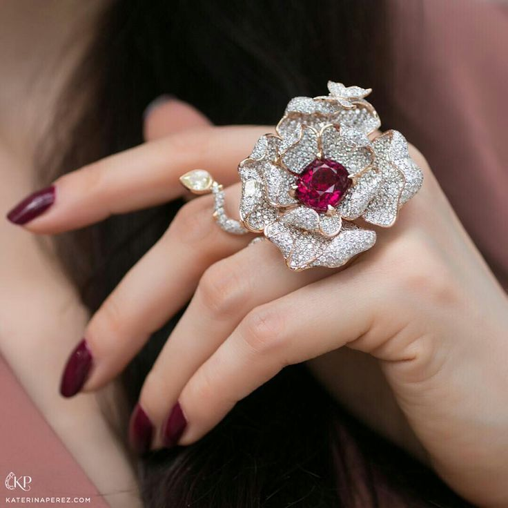 @katerina_perez.  Gorgeous rose ring by José María Goñi @jmgdesigner who is currently exhibiting at the Hong Kong jewellery show. The cocktail piece features a 9.40cts rubellite in the centre surrounded by 9.58cts colourless diamonds and one yellow diamond 0,52cts