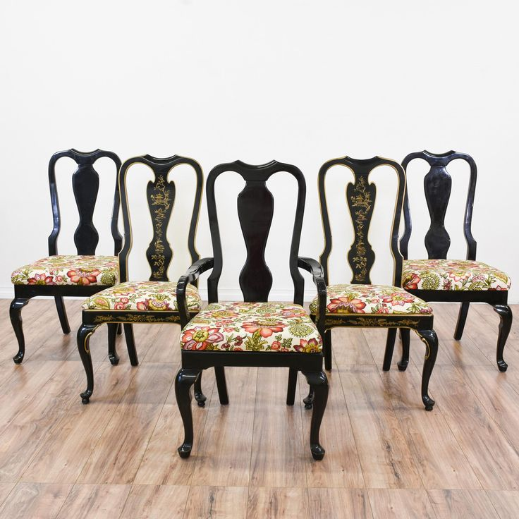 This set of 5 Queen Anne chairs are featured in a solid wood with a gorgeous glossy black lacquer finish and gold asian accents. These dining chairs are in great condition with cabriole legs, white upholstered cushions in vibrant colorful floral print and tall carved backs. Eclectic chairs perfect for formal and casual dining! #eclectic #chairs #diningchair #sandiegovintage #vintagefurniture