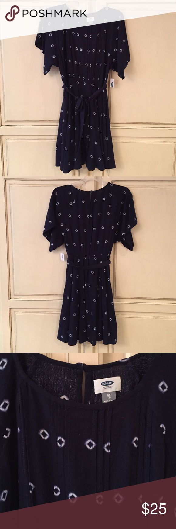 NWT Old Navy size XS casual dress NWT Old Navy size XS casual dress. Elastic waist. Pleated across the front of the body. Ties around the waist. Buttons at the back of the neck. Old Navy Dresses