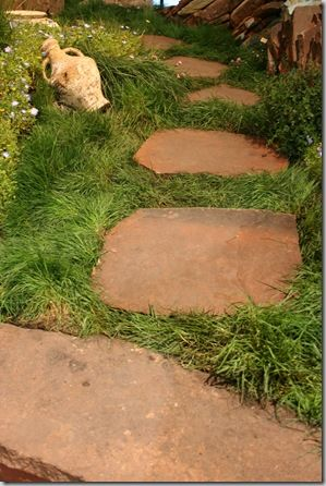 This urn is casually strewn along this no-mow pathway. Love the ancient Greek elegance! From the SF Garden Show 2012.: Flagstone Path