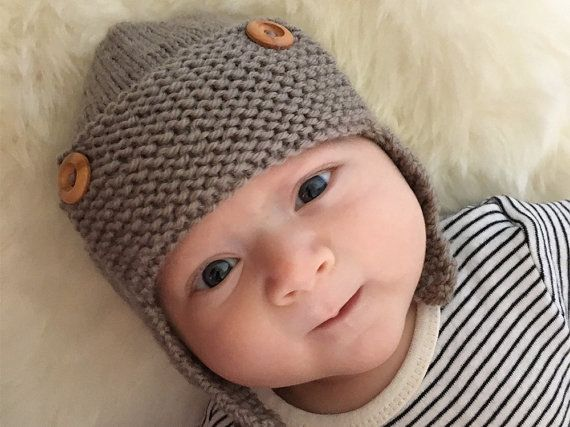 Regan is a simple knitting pattern for an aviator hat. There are 6 sizes from newborn to child (5T+) It is knit in the round. The hat fastens with a button under the chin to keep little heads snug and warm, and tiny toddler hands from pulling it off after two seconds, but if you are knitting for an older child and want the earflaps to hang freely just make two of the left earflap and don't add a button – simple!  SIZES: Instructions are given for 6 sizes 0 - 3 months, 3 - 6 months, 6 - 12…