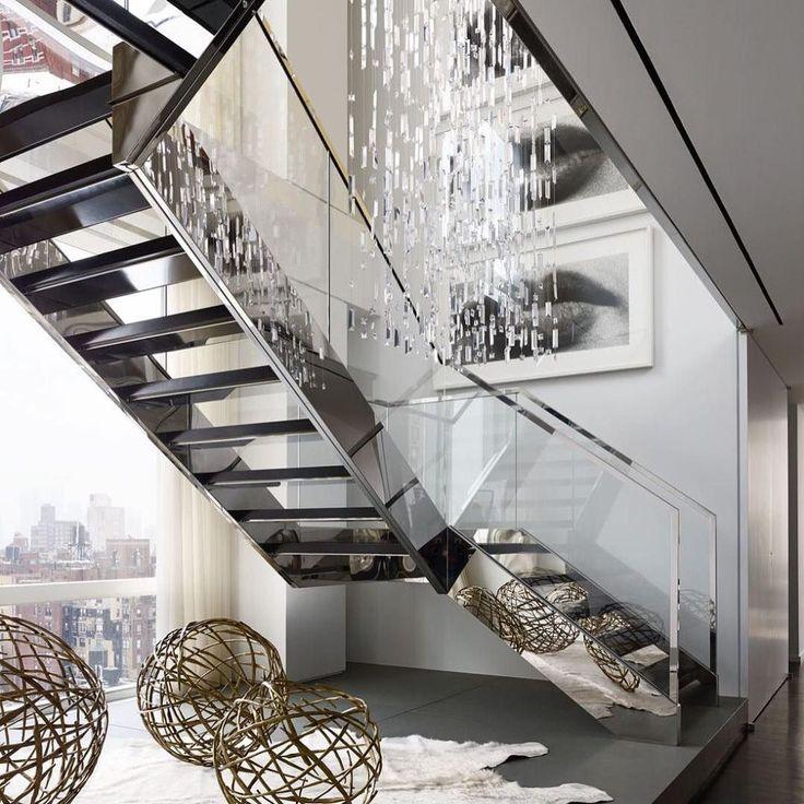 [repost] We can't decide what we love more. That gorgeous Swarovski crystal chandelier, or the framed photographs by Sam Samore! . . . Gorgeous stairwell inside a glassy Manhattan duplex.   Photo: @bjornwallander; Design: @russellgroves #interiordesign #housetour #instadecor (@elledecor) . . . #interior #interiors #interiordecor #interiordesign  #home #homedesign #homedecor #art #artwork ##luxuryinteriors #luxuryhomes #architecture #USA #samsamore #swarovski #manhattan #newyork