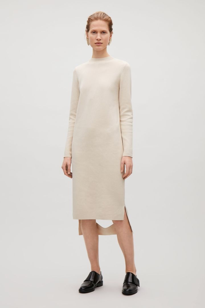COS image 1 of Knit dress with cut-out hem in Stone