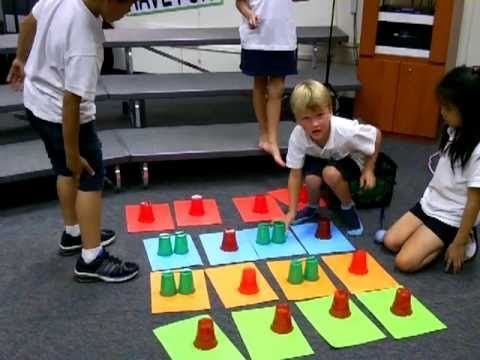 """Ta TiTi Notation using plastic cups - She used """"2,4,6,8, Meet Me at the Garden Gate"""""""