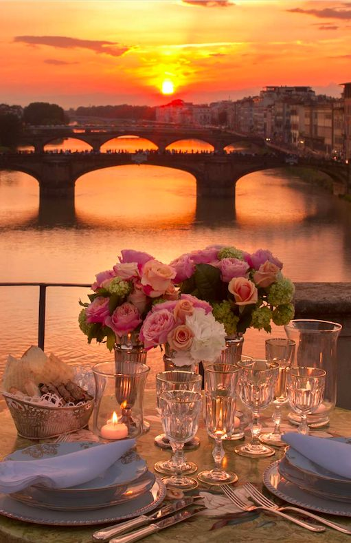 A romantic dinner at the Four Seasons Hotel Firenze on Ponte Vecchio overlooking the Arno River in Florence, Italy • photo: Four Seasons