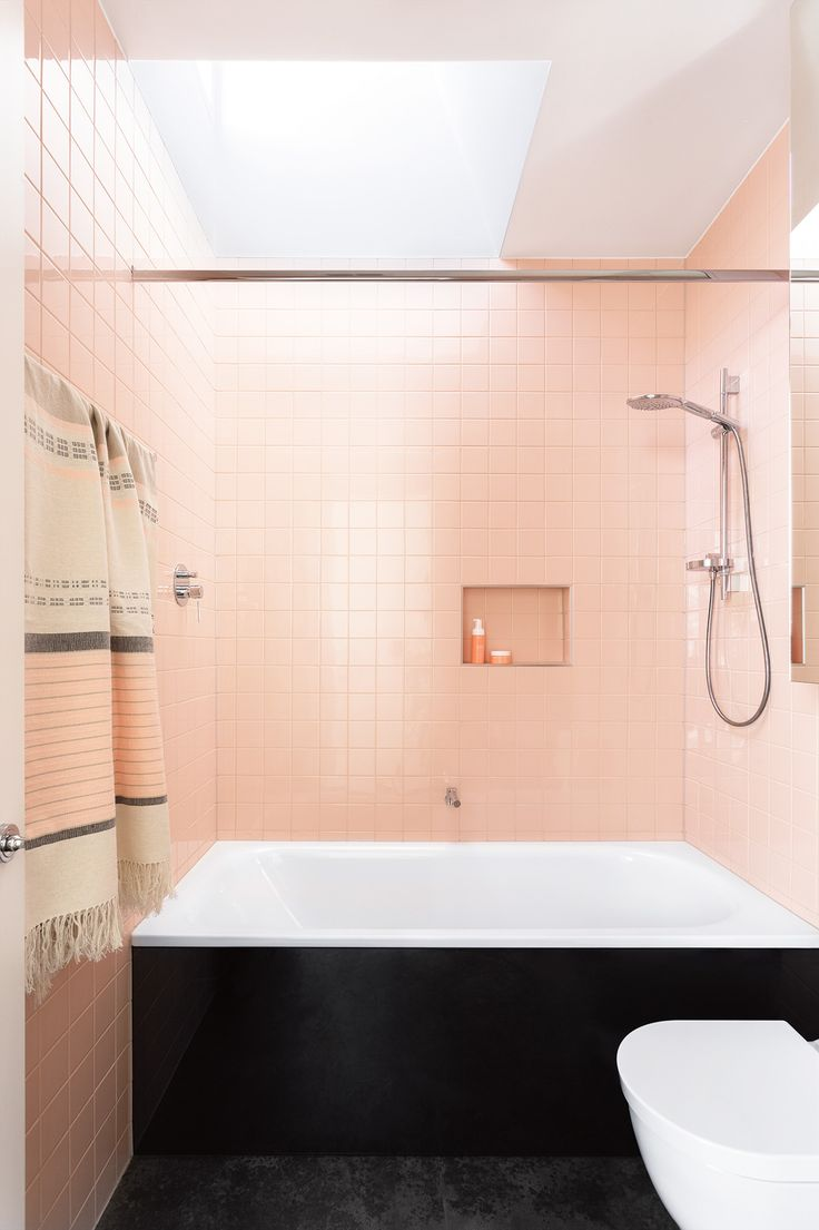 """Dusty pink tiles from <a href=""""http://www.classicceramics.com.au/"""" rel=""""noopener"""" target=""""_blank"""">Classic Ceramics </a> make this the ultimate girls' bathroom. A mirrored shaving cabinet and skylight keep the small spot feeling bright and open. """"It allows the light to filter down onto the beautiful tiles,"""" says architect Monique. Photography by Martina Gemmola. Styling by Ruth Welsby."""